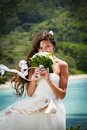 Wedding bouquet and groom of frangipani against the background the bay seychelles Royalty Free Stock Photo
