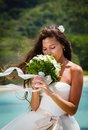 Wedding bouquet and groom of frangipani against the background the bay seychelles Stock Photos