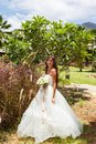 Wedding bouquet and groom of frangipani against the background tropical vegetation Stock Photo