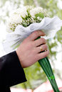 Wedding bouquet at groom's hands Royalty Free Stock Images