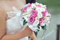 Wedding bouquet in hand Royalty Free Stock Images