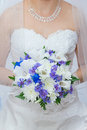 Wedding bouquet in hands of the bride Stock Photo