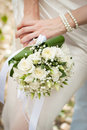 Wedding bouquet is in the hands of fiancee Royalty Free Stock Photos