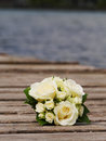 Wedding bouquet lying on jetty Royalty Free Stock Photography