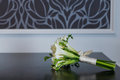 Wedding bouquet lying on a table in a hotel room selective focus on a Stock Image