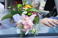 Wedding bouquet of orchids and roses in hand the bride Royalty Free Stock Photos