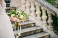 Wedding bouquet of peonies in the hands of the bride. Wedding in Royalty Free Stock Photo