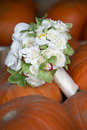 Wedding bouquet on pumpkins Royalty Free Stock Photography