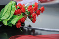Wedding bouquet red roses as on a car hood Royalty Free Stock Images