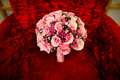 Wedding bouquet red sofa Royalty Free Stock Images