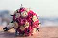 Wedding bouquet of red white roses lying on a stone Royalty Free Stock Images