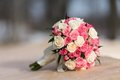 Wedding bouquet of red white roses lying on a stone Stock Image