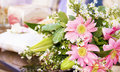 Wedding bouquet and ring pillow in background Royalty Free Stock Photo