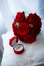 Wedding bouquet and rings Stock Image