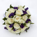 Wedding bouquet with rose and lisianthus lying on snow Stock Photos