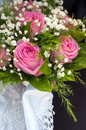 Wedding bouquet of roses against the background newlyweds Stock Photography