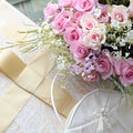 Wedding bouquet of roses bag and elegant box with bow Royalty Free Stock Photo