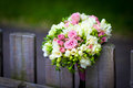 Wedding bouquet on rustic country fence Royalty Free Stock Photo