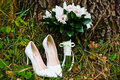 Wedding bouquet with shoes Stock Image
