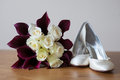 Wedding bouquet and shoes of the bride Stock Photo