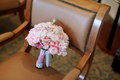 Wedding bouquet on a sofa Royalty Free Stock Photography