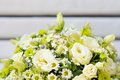 Wedding bouquet with two wedding rings beautiful flowers Royalty Free Stock Images