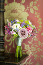 Wedding bouquet and vintage wallpaper Stock Image