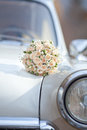 Wedding bouquet on vintage wedding car Royalty Free Stock Photo