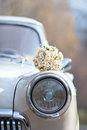 Wedding bouquet on vintage wedding car the Royalty Free Stock Photography