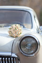 Wedding bouquet on vintage wedding car the Royalty Free Stock Image