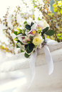 Wedding bouquet of white flowers lying on stone Royalty Free Stock Photo