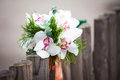 Wedding bouquet white orchids rustic country fence Royalty Free Stock Photo