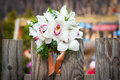 Wedding bouquet white orchids rustic country fence Stock Photo