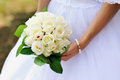 Wedding bouquet of white roses in bride s hands Royalty Free Stock Images