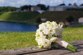 Wedding bouquet with white roses laying on bench Royalty Free Stock Images