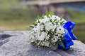 Wedding bouquet of white roses lying on a stone Stock Photography