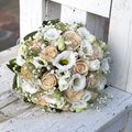 Wedding bouquet of yellow and cream roses in the vase Royalty Free Stock Image