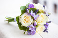 Wedding bouquet with yellow roses and lavender flowers Stock Photo