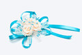 Wedding boutonniere made ​​of artificial flowers and blue ribbons isolated on white Stock Images