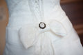 Wedding bow dress of fiancee lacing of clothes Royalty Free Stock Image