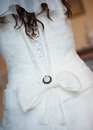 Wedding bow dress of fiancee lacing of clothes Royalty Free Stock Photos