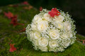Wedding bridal bouquet with autumn leaf white roses and on stone Royalty Free Stock Image