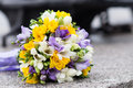 Wedding bridal bouquet and wedding rings on the granite pavement Stock Photos