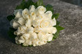 Wedding bridal bouquet with white roses on stone Royalty Free Stock Photo