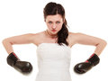 Wedding bride in boxing gloves emancipation dress wearing woman showing her power domination isolated Royalty Free Stock Images