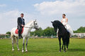 Wedding bride and groom on horseback beautiful Stock Photo