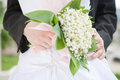 Wedding bunch of flowers and hug Royalty Free Stock Photo