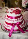 Wedding cake beautiful pink with pink ribbons Royalty Free Stock Photos
