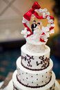 Wedding cake with a bride and groom topper Royalty Free Stock Photo