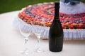 Wedding Cake and Champagne Bottle Royalty Free Stock Photo